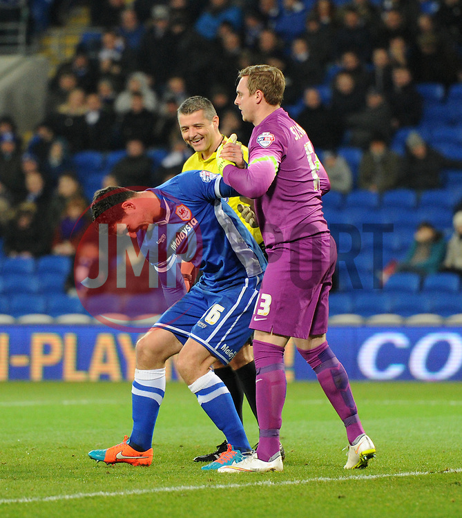 Cardiff City's Matthew Connolly is helped to his feet by Brighton and Hove Albion's David Stockdale  - Photo mandatory by-line: Paul Knight/JMP - Mobile: 07966 386802 - 10/02/2015 - SPORT - Football - Cardiff - Cardiff City Stadium - Cardiff City v Brighton & Hove Albion - Sky Bet Championship