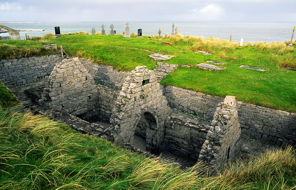 Early Celtic Christian Church of St. Cavan. Now sunk in the sand dunes on the Aran Island of Inisheer, County Galway, Ireland.