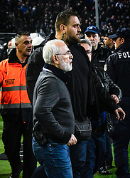 March 11, 2018 - Thessaloniki, Greece - PAOK owner, businessman Ivan Savvidis invades into the pitch during the Greek League soccer match between PAOK and AEK Athens in the northern Greek city of Thessalonik. Savvidis invaded the pitch twice. The second time, without the overcoat he was wearing before, a pistol was clearly visible in its holder. AEK officials claim Savvidis threatened the referee during his first foray into the pitch, before being pulled away by his retinue. (Credit Image: © Eurokinissi via ZUMA Wire)