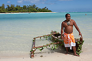 Cook islands, New Zealand, Local man in a dugout canoe
