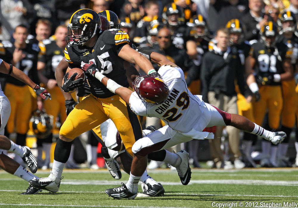 September 22 2012: Iowa Hawkeyes fullback Mark Weisman (45) stiff arms Central Michigan Chippewas defensive back Jarret Chapman (29) during the second half of the NCAA football game between the Central Michigan Chippewas and the Iowa Hawkeyes at Kinnick Stadium in Iowa City, Iowa on Saturday September 22, 2012. Central Michigan defeated Iowa 32-31.