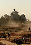 A person walks on a trail at Benazir Bhutto's family graveyard in Ghari Khuda Baksh, Larkana, Pakistan.