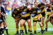 The front row prepare to scrum down, Wellington Hurricanes, Super 12 rugby union, 1998. Photo: Andrew Cornaga/PHOTOSPORT
