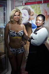 © licensed to London News Pictures. LONDON, UK  05/05/2011. Lingerie model Amanda-Jane (L) and head lingerie fitter Mina Abban-Mensah (R) conduct a live bra fitting in the store window of Debenhams on Oxford Street. .85% of British women are thought to wear the wrong size bra. A fitting will take place on the hour until 4pm today. Please see special instructions for usage rates. Photo credit should read CLIFF HIDE/LNP