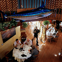 BOCA GRANDE, FL -- January 3, 2008 -- Diners eat at PJ's Seagrille, which was a 1920's historic theater, in Boca Grande, Fla., on Saturday, January 3, 2008.  Boca Grande is a small Old-Florida community on Gasparilla Island, with no traffic lights, billboard or condo development, which attracts both seasonal and year-round affluent residents.