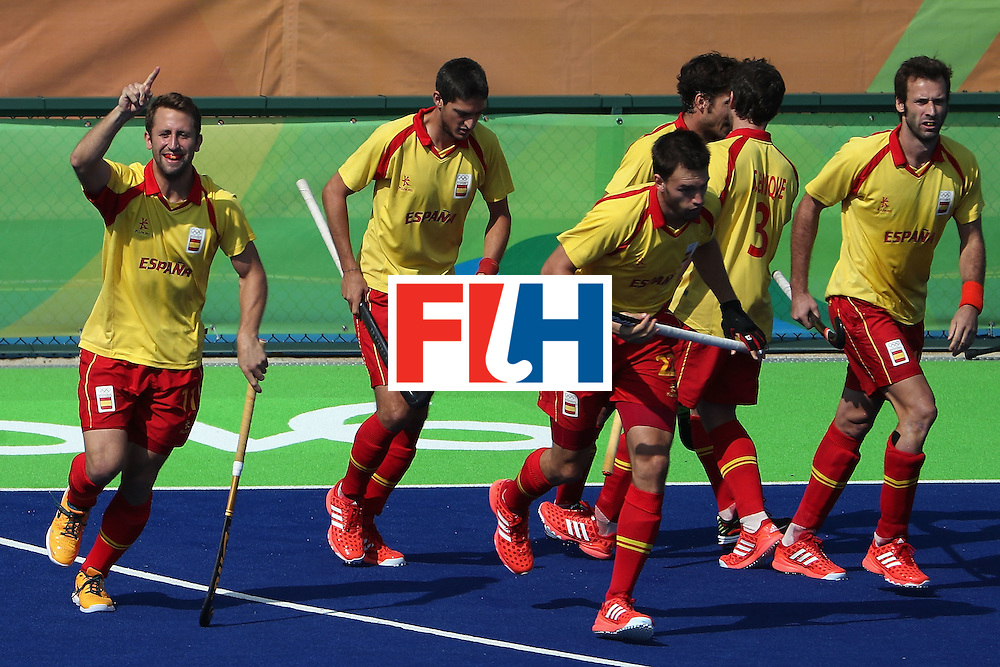 RIO DE JANEIRO, BRAZIL - AUGUST 09:  Roc Oliva #11 (L) of Spain celebrates a goal against New Zealand during the hockey game on Day 4 of the Rio 2016 Olympic Games at the Olympic Hockey Centre on August 9, 2016 in Rio de Janeiro, Brazil.  (Photo by Christian Petersen/Getty Images)