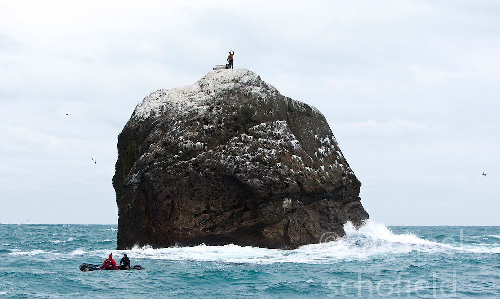 Nick Hancock (yellow dry suit), on the top of Rockall, on his reconnaissance mission for a future 60 day occupation of Rockall, an extremely small, uninhabited, remote rocky islet in the North Atlantic Ocean. .The Rockall Jubilee Expedition, a unique endurance expedition to be undertaken by Nick, in order to raise funds for Help for Heroes.