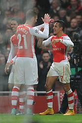 Arsenal's Alexis Sanchez celebrates his goal with Arsenal's Calum Chambers - Photo mandatory by-line: Dougie Allward/JMP - Mobile: 07966 386802 - 26/11/2014 - SPORT - Football - London - Emirates Stadium - Arsenal v Borussia Dortmund - Champions League - Group D
