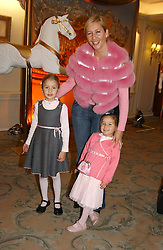 TANIA BRYER and her daughters NATASHA & FRANCESCA MOUFFARIGE  at a children's party in aid of the charity Over The Wall held at Fortnum & Mason, Piccadilly, London before a gala premiere of the new musical Mary Poppins at The Prince of Wales Theatre, Old Compton Street, London W1<br /><br />NON EXCLUSIVE - WORLD RIGHTS