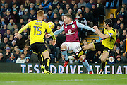 Burton Albion defender Tom Naylor (15) and Burton Albion midfielder John Mousinho (4) fight Aston Villa striker Ross McCormack (44) for the ball during the EFL Sky Bet Championship match between Aston Villa and Burton Albion at Villa Park, Birmingham, England on 26 December 2016. Photo by Richard Holmes.