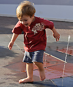 Boy Playing In Water At Fashion Island