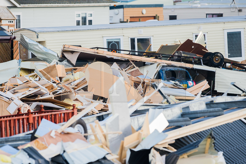 © London News Pictures. Aberystwyth,UK. 17/11/2016.<br /> Some 20 caravans in total damaged, including 2  brand new £55,000 units at Clarach Bay Holiday Village in Aberystwyth. A tornado , with winds of over 80mph, reportedly tore through the town of Aberystwyth on the morning of Nov 17, bringing extensive damage in its wake.  Slates were blown off roofs, windows sucked out, and chimney stacks destroyed, Large  parts of the town have been closed to traffic and pedestrians because of the risk of further damage. Photo credit: Keith Morris/ LNP