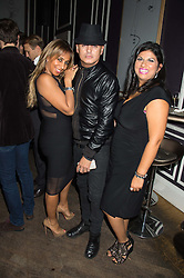 Left to right, NADIA DE-MIMAL , STUART WATTS and SOHERE ROKED at the Tatler Little Black Book Party at Home House Member's Club, Portman Square, London supported by CARAT on 11th November 2015.