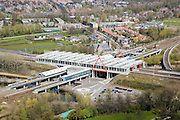 Nederland, Noord-Holland, Duivendrecht, 16-04-2008; station Duivendrecht, kruispunt van spoorwegen; Sint-Urbanuskerk en dorpskern in de achtergrond..luchtfoto (toeslag); aerial photo (additional fee required); .foto Siebe Swart / photo Siebe Swart.