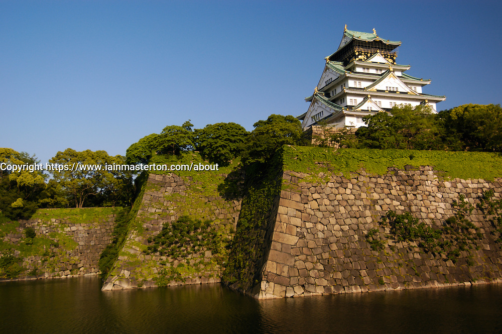 Historic Osaka Castle high above the outer walls and moat