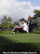Fourteen year old Michelle Wie relaxes in the tee box during a practice round on the eve of her PGA tournament prior to The 2004 Sony Open In Hawaii. The event was held at The Waialae Country Club in Honolulu.