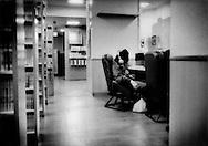 "Homeless man falls asleep in ""mangakissa"" internet comic cafe after midnight, Kabuki-cho, Tokyo, Japan."