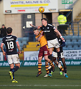 24th February 2018, Dens Park, Dundee, Scotland; Scottish Premier League football, Dundee versus Motherwell; Josh Meekings of Dundee heads clear from Allan Campbell of Motherwell