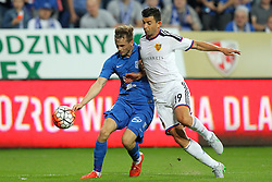 29.07.2015, INEA Stadion, Poznan, POL, UEFA CL, Lech Poznan vs FC Basel, Qualifikation, 3. Runde, Hinspiel, im Bild (L) TOMASZ KEDZIORA (P) BEHRANG SAFARI // during the UEFA Champions League Qualifier, third round, first Leg match between Lech Posen and FC Basel at the INEA Stadion in Poznan, Poland on 2015/07/29. EXPA Pictures © 2015, PhotoCredit: EXPA/ Newspix/ Wojciech Klepka<br /> <br /> *****ATTENTION - for AUT, SLO, CRO, SRB, BIH, MAZ, TUR, SUI, SWE only*****