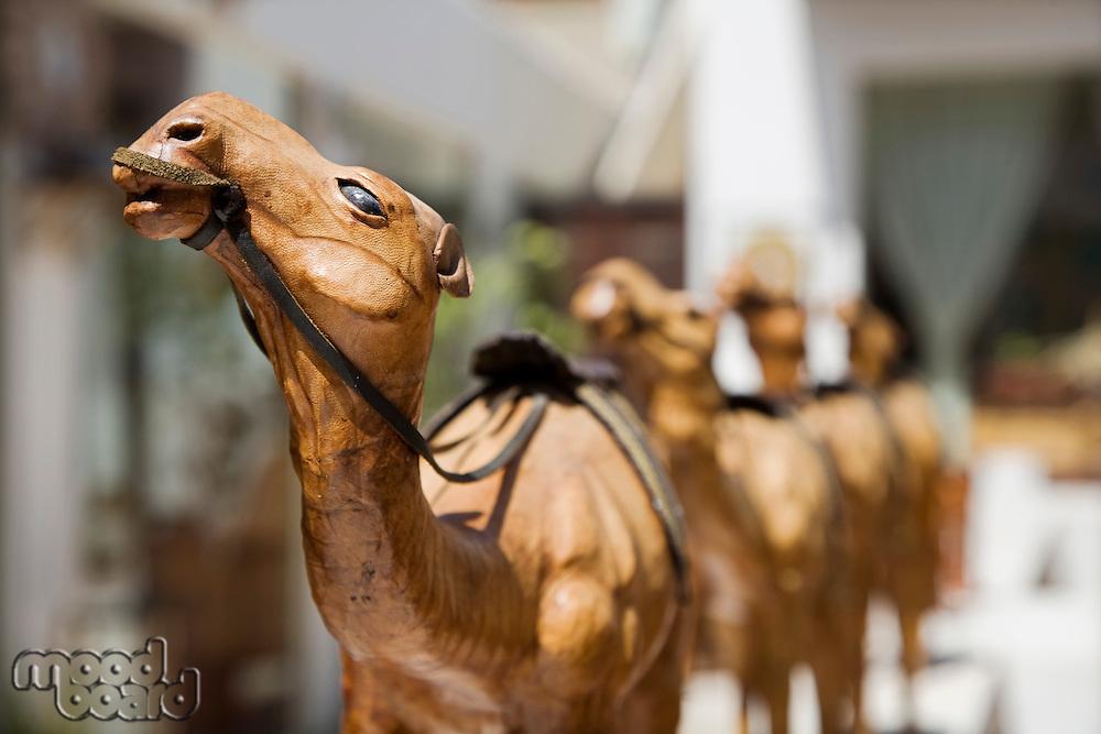 UAE, Dubai, wooden carved camels on display in the old Bastakia Quarter in Bur Dubai