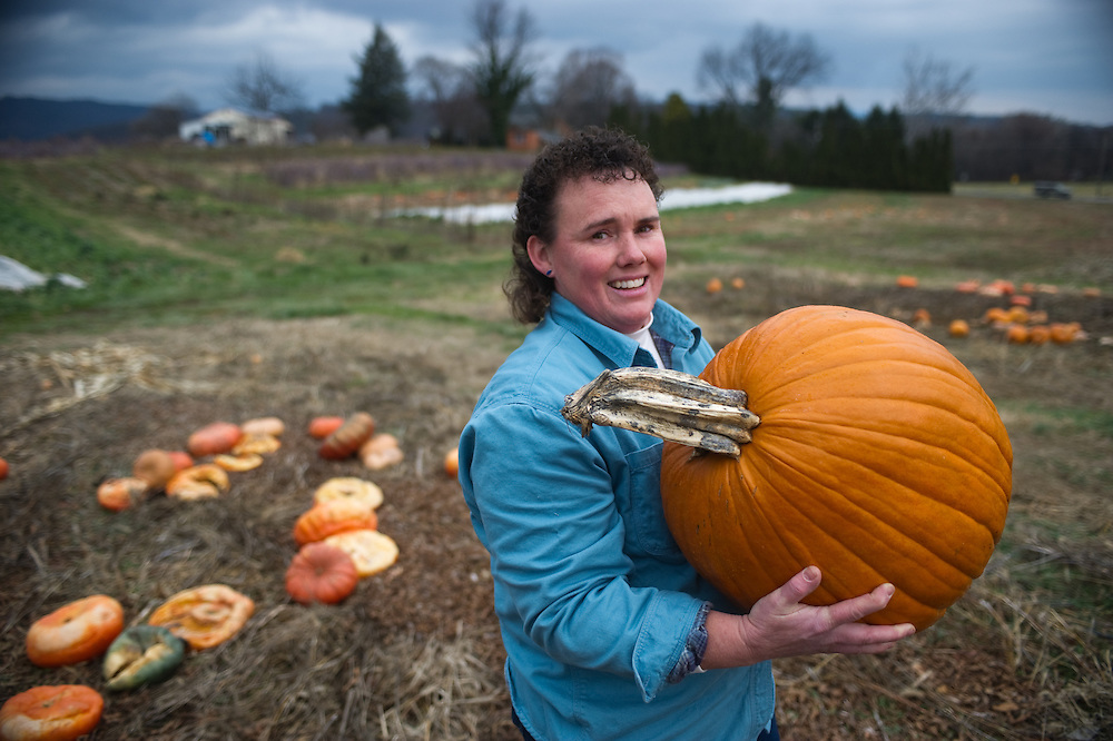Farmer with pumpkin, Arendtsville, PA.