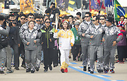 You Young, Nov 1, 2017 : South Korean figure skater You Young (C) who is the first torch bearer runs with an Olympic torch at the Olympic Torch Relay on the Incheon Bridge in Incheon, west of Seoul, South Korea. The Olympic flame arrived in Incheon, South Korea on Wednesday and it is going to be passed across the country during a 100-day tour until the opening ceremony of the 2018 PyeongChang Winter Olympics which will be held for 17 days from February 9 - 25, 2018. Photo by Lee Jae-Won (SOUTH KOREA) www.leejaewonpix.com