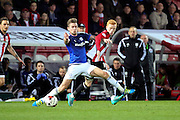Cardiff City midfielder, Joe Ralls (8) tackling Brentford midfielder, Ryan Woods (15) during the Sky Bet Championship match between Brentford and Cardiff City at Griffin Park, London, England on 19 April 2016. Photo by Matthew Redman.