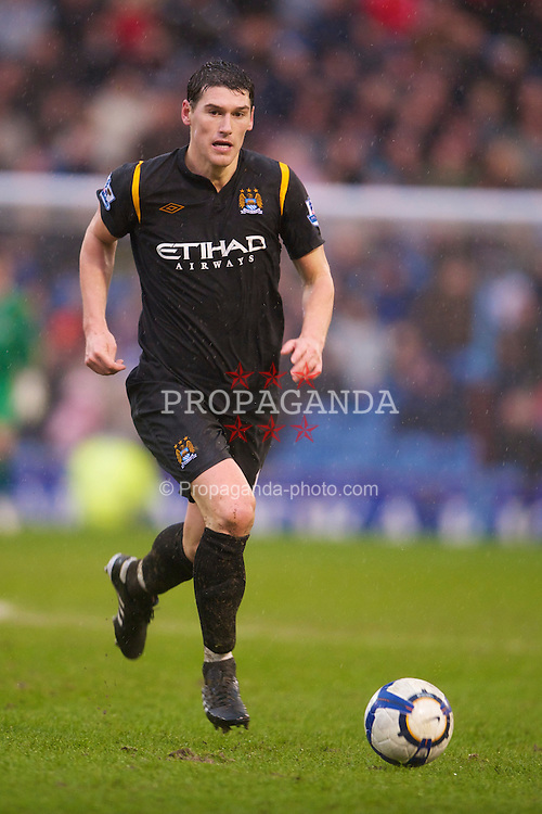 BURNLEY, ENGLAND - Saturday, April 3, 2010: Manchester City's Gareth Barry in action against Burnley during the Premiership match at Turf Moor. (Photo by David Rawcliffe/Propaganda)