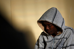 A Somali immigrant sits in the common room at the Lyster Barracks detention centre in Hal Far, outside Valletta, January 20, 2012.  68 Somali immigrants who were rescued while fleeing from Libya on January 15 are being held in the camp by Maltese authorities while their requests for humanitarian protection are processed, government officials said. REUTERS/Darrin Zammit Lupi (MALTA - Tags: POLITICS SOCIETY IMMIGRATION) MALTA OUT. NO COMMERCIAL OR EDITORIAL SALES IN MALTA - RTR2WL04