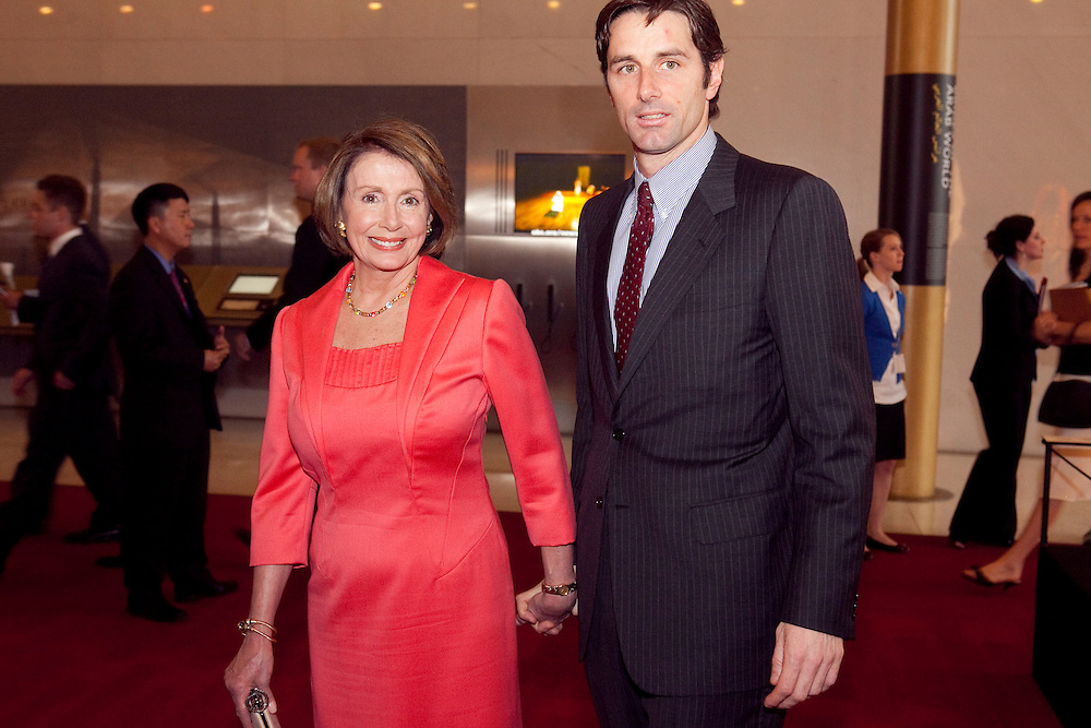House Speaker Nancy Pelosi (D-CA) arrives with her son at the Kennedy Center for a tribute concert to Sen. Edward Kennedy (D-MA) on Mar. 8, 2009 in Washington, DC.