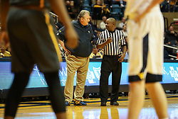 Dec 20, 2017; Morgantown, WV, USA; West Virginia Mountaineers head coach Bob Huggins talks to a referee during the second half against the Coppin State Eagles at WVU Coliseum. Mandatory Credit: Ben Queen-USA TODAY Sports