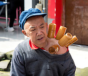 Traditional Chinese medicine, Cupping therapy, with bamboo cups Photographed in Chengdu, Sichuan, China