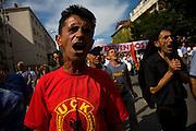 "Vetvendosje (""Self-Determination"" in Albanian) protest. Albanian man yelling slogans, wearing a t-shirt of the KLA (Kosovo Liberation Army) on the streets of Prishtina...Pristina, Kosovo, Serbia."