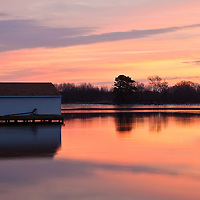 Dawn civil twilight and the refuge boathouse reflected in the waters of the Little Blackwater River, Blackwater National Wildlife Refuge, Cambridge, Maryland.