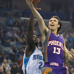 Feb 01, 2010; New Orleans, LA, USA; Phoenix Suns guard Steve Nash (13) shoots over New Orleans Hornets guard Darren Collison (2) during the first half at the New Orleans Arena. Mandatory Credit: Derick E. Hingle-US PRESSWIRE
