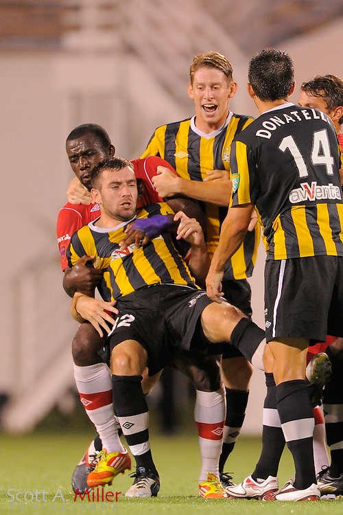 Orlando City Lions midfielder Jean Alexandre (19) pulls Charleston Battery defender Colin Falvey (32) to the ground during a fight in the game at the Florida Citrus Bowl on July 27, 2012 in Orlando, Florida. ..© 2012 Scott A. Miller..