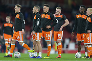 Blackpool players Blackpool midfielder Harry Pritchard (14) Blackpool midfielder Jay Spearing (8) Blackpool midfielder John O'Sullivan (18) Blackpool defender Oliver Turton (20) Blackpool striker Mark Cullen (9) warming up before the EFL Cup 4th round match between Arsenal and Blackpool at the Emirates Stadium, London, England on 31 October 2018.