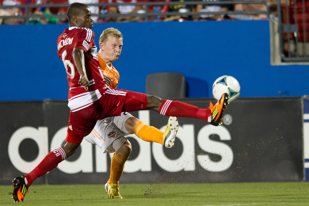 FRISCO, TX - JUNE 12:  Jackson #6 of FC Dallas blocks a cross attempt from Andrew Driver #20 of the Houston Dynamo on June 12, 2013 at FC Dallas Stadium in Frisco, Texas.  (Photo by Cooper Neill/Getty Images) *** Local Caption *** Jackson; Andrew Driver