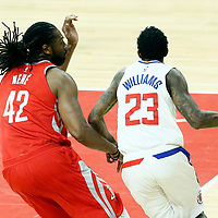 28 February 2018: LA Clippers guard Lou Williams (23) drives past Houston Rockets center Nene Hilario (42) during the Houston Rockets 105-92 victory over the LA Clippers, at the Staples Center, Los Angeles, California, USA.
