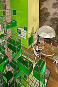 USM Modular Furniture Installation designed by Ghiora Aharoni Design Studio, green-upholstered Tate chair by Cappellini, 'Metropolis' by Lladró, Ghiora Aharoni Design Studio 'Redux Series (Hermes), Ovando: Floral Design and Event Production candle, Gregory Sparks 'Knot 12', Ilmari Tapiovaara (Artek, Usa) Mademoiselle Lounge Chair, Charles Broderson 'Nocturnal Forest', Joe Robbins Peg and Plank table, Tracey Langfitt 'Comic Books', Alexa Hoyer 'Sidewalk Dome', Architectural Systems Ornamental Surface reflective flooring