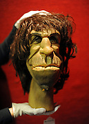 © Licensed to London News Pictures. 08/12/2011, London, UK. A Bonhams employee holds a puppet from satirical television programme Spitting Image of Rolling Stone, Keith Richards. The pupaet is expected to fetch 600-800 GBP.  Bonhams, London, photocall for entertainment memorabilia today, 8th December 2011. The auction takes place on Thursday 15th DecemberPhoto credit : Stephen Simpson/LNP
