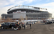The Sports Authority Field at Mile High stadium stands tall in the background as fans begin tailgating in this wide angle, general view photograph taken before the Cincinnati Bengals 2015 NFL week 16 regular season football game against the Denver Broncos on Monday, Dec. 28, 2015 in Denver. (©Paul Anthony Spinelli)