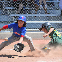 062715       Cayla Nimmo<br /> <br /> Athletic's runner Emilio Garcia (21) slides in to home plate before Ranger's pitcher Isaiah Martinez (1) can catch the ball) in the tournament game held at Ford Canyon Park in Gallup Saturday.