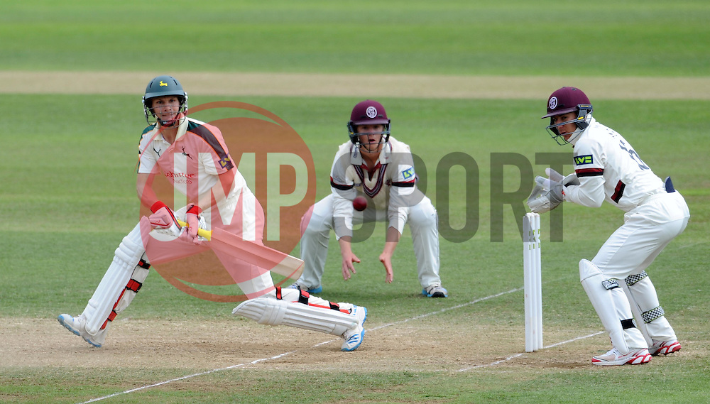 Nottinghamshire's Will Gidman reverse sweeps the ball. - Photo mandatory by-line: Harry Trump/JMP - Mobile: 07966 386802 - 16/06/15 - SPORT - CRICKET - LVCC County Championship - Division One - Day Three - Somerset v Nottinghamshire - The County Ground, Taunton, England.