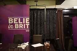 "© London News Pictures. ""Looking for Nigel"". A body of work by photographer Mary Turner, studying UKIP leader Nigel Farage and his followers throughout the 2015 election campaign. PICTURE SHOWS - Karaoke style curtains are revealed behind UKIP's campaign backdrop at the Holly Tree Inn in Margate, after a  public meeting was held at the venue in Kent on March 25th 2015. Mr Farage spoke at traditional venues such as pubs, club, village and community halls along the way on his campaign, hoping to secure the audience's vote. . Photo credit: Mary Turner/LNP **PLEASE CALL TO ARRANGE FEE** **More images available on request**"