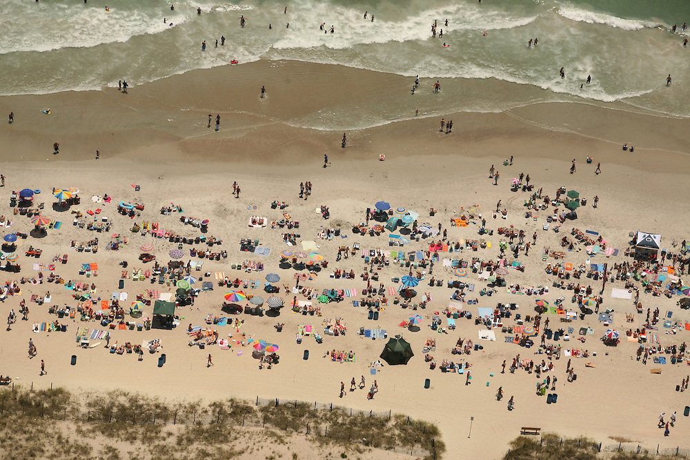 Aerial image of people and crowds on Wrightsville Beach, North Carolina.
