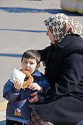Istanbul. Mother and boy with sesame roll.
