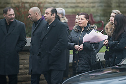 © Licensed to London News Pictures . 16/01/2017 . Oldham , UK .  Helena Kotlarova's father ROBERT (3rd from left) . The funeral of cousins Helina Kotlarova and Zaneta Krokova at St Paul's Church in Oldham . The two girls , aged 12 and 11 respectively , were killed by a hit and run driver whilst crossing the road together , on New Years Eve (31st December 2016) . Photo credit: Joel Goodman/LNP