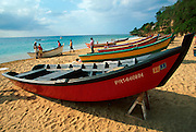 PUERTO RICO, INDUSTRY fishing boats on shore near Aguadilla in the northwest corner of the island