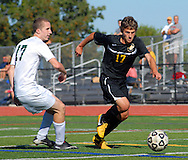 PERKASIE, PA -  SEPTEMBER 18:  Pennridge's Phelim Giblin (17), left,  defends against Central Bucks West's Jack Tilley (17) during a soccer game at Pennridge September 18, 2013 in Perkasie, Pennsylvania. (Photo by William Thomas Cain/Cain Images for the Intelligencer)